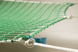 safety net with suspension ropes in green
